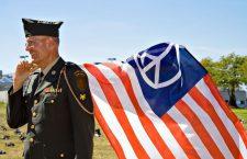 Pictured: A Vietnam War Veteran waving a peace flag.